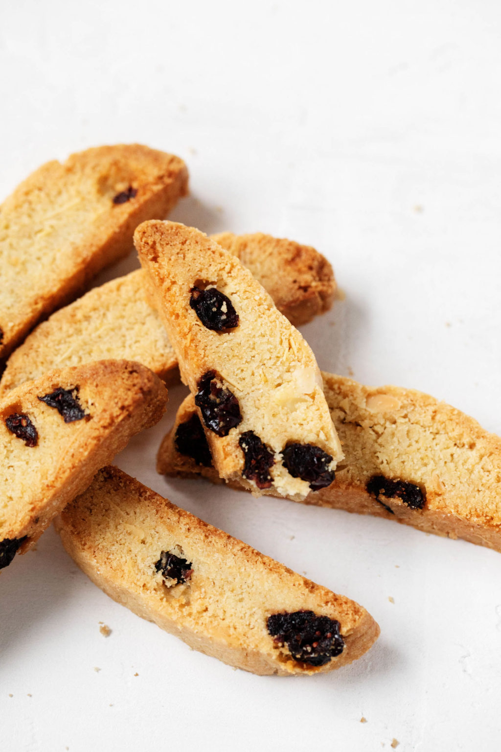 A small pile of vegan biscotti cookies, studded with cranberries.