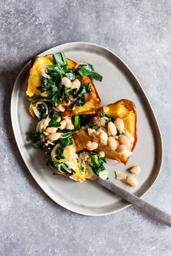 Stuffed Acorn Squash with Garlicky Beans & Greens