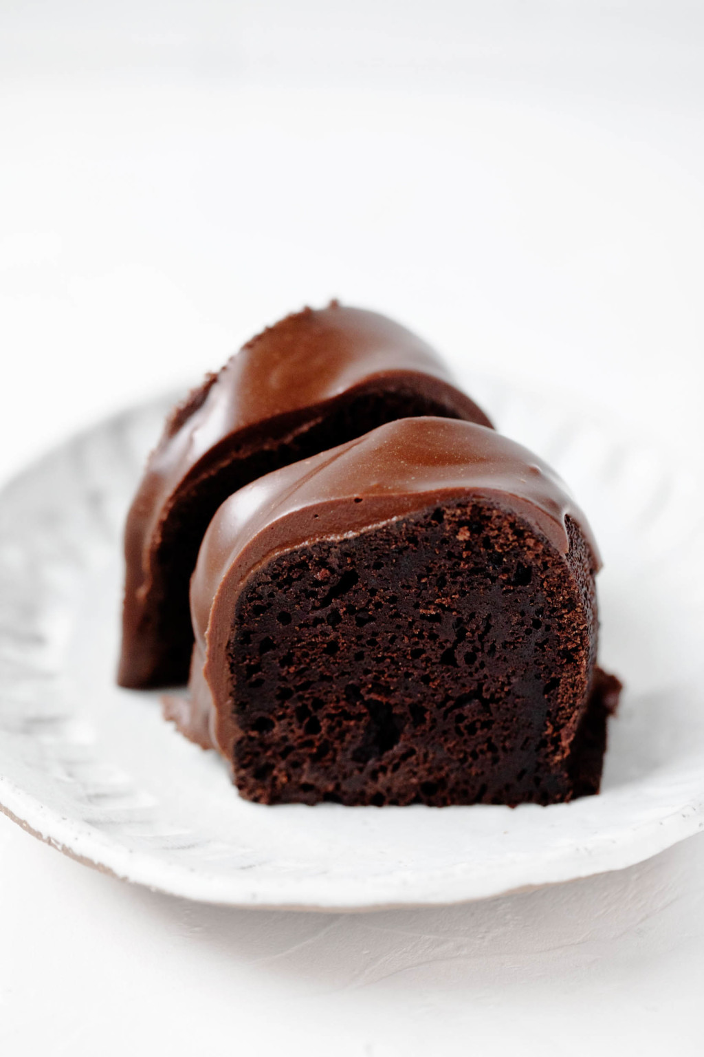 Two crosswise slices of a vegan chocolate bundt cake.